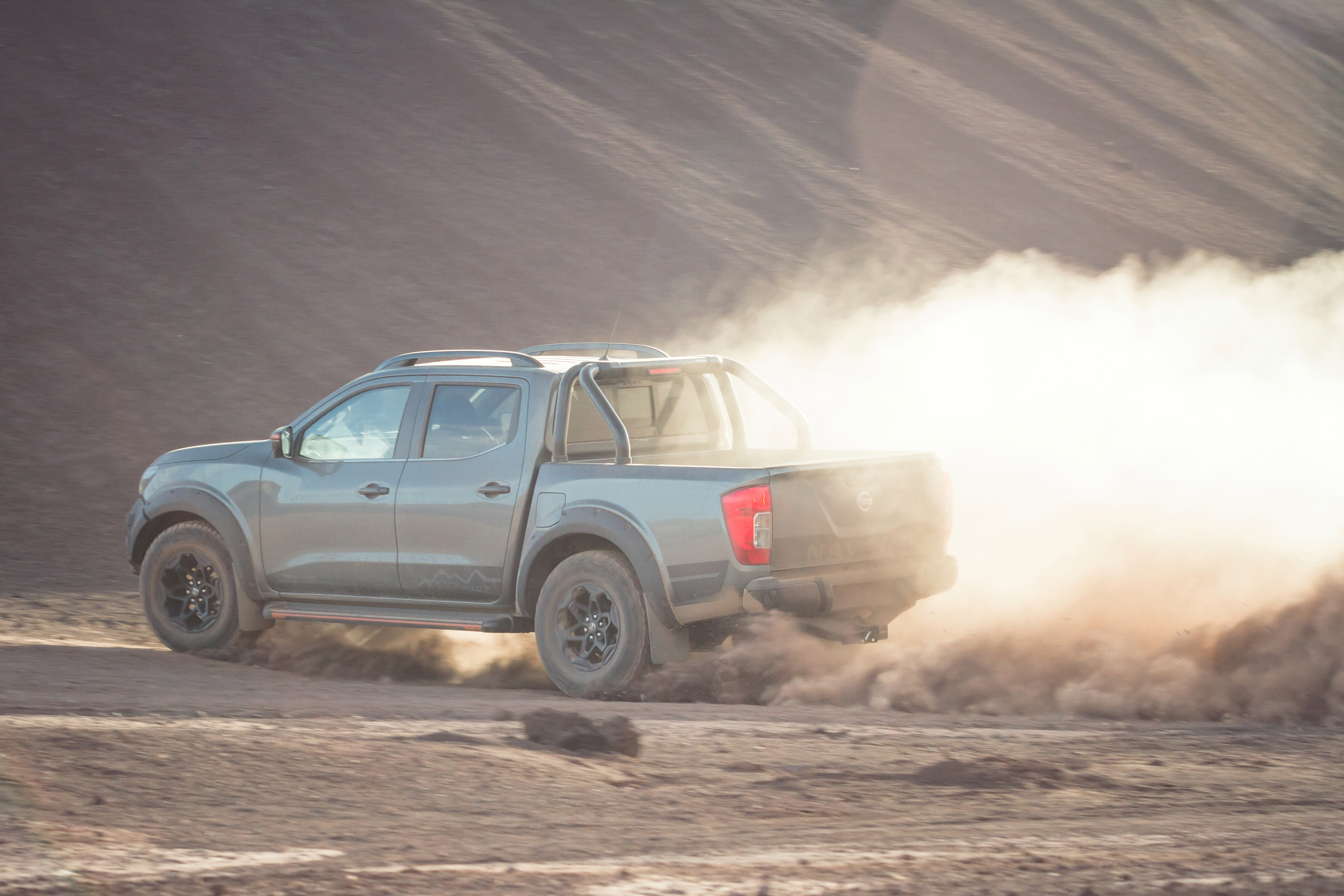 Nissan Navara N-TREK Warrior 15 driving on dirt